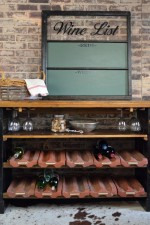 Rustic Wine Cellar Table with Terra Cotta Roof Tile Wine Supports