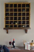 Wall mounted wine rack made from old tool bin