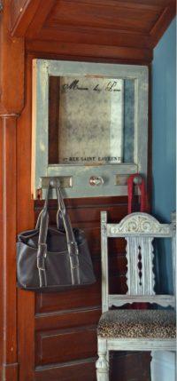 mirror with coat hooks